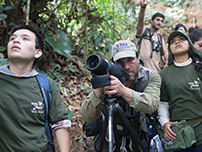 Explorers registering the name of the bird in the middle of natural forest of Tambopata.